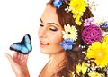 Woman with flower and  butterfly. Stock Image