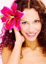 Woman with flower in her curl hair portrait of a Stock Photos