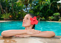Woman with flower in pool Royalty Free Stock Photography
