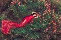 Woman in flower poppy field in summer Royalty Free Stock Photo