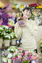 Woman in flower shop Stock Images