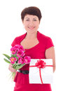 Woman with flowers and gift box isolated on white background Royalty Free Stock Images