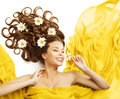 Woman Flowers in Hair, Beauty Model Smelling Flower Curly Hairstyle Royalty Free Stock Photo