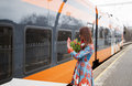 Woman with flowers salute to train passanger young Stock Images