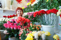 Woman in flowers shop Royalty Free Stock Images