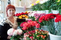 Woman in flowers shop Stock Photography