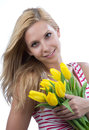 Woman with flowers yellow spring tulips bouquet Royalty Free Stock Image