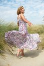Woman with flowing dress at the beach portrait of a beautiful older Royalty Free Stock Photography
