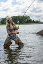 Woman fly fishing beautiful young with capture on Royalty Free Stock Photo
