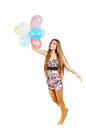 Woman flying balloons isolated white Stock Photography
