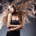 Woman with flying hair posing Stock Images