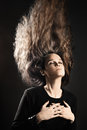 Woman with flying hair style long hairstyle model on black Stock Photos