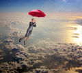 Woman flying in the sky with umbrella Royalty Free Stock Photo