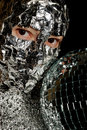 Woman with a foil and disco ball Stock Image
