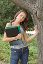 Woman with folders by tree Royalty Free Stock Images