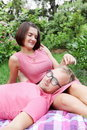 Woman Fondling Man on Picnic Royalty Free Stock Image