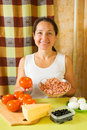 Woman with food products for farci tomato Stock Photography