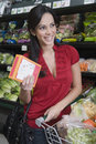 Woman food shopping in supermarket portrait of a smiling young women Stock Image