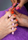 Woman foot in nail polishing salon pedicure treatment Stock Photos