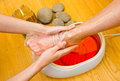 Woman foot in paraffin bath at the spa treatment Royalty Free Stock Image