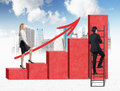 A woman in formal clothes is going up through a red bar chart while a man has found a shortcut how to reach the final point of th Stock Photo