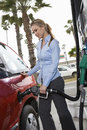Woman In Formal Wear Refueling Her Car Stock Images
