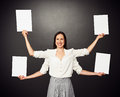 Woman with four hands holding white boards smiley empty Stock Image