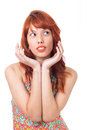 Woman frames her face with her hands. Female model. Redhead girl