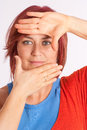 Woman framing her face with her hands Royalty Free Stock Photo