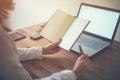 Woman freelancer working at home telework taking notes. Royalty Free Stock Photo