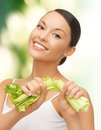 Woman with fresh celery Stock Photography