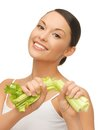 Woman with fresh celery picture of beautiful Stock Photography