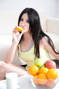 Woman with fresh fruits orange Stock Photo