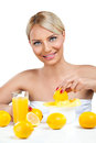 Woman with fresh lemonade beautiful squeeze on juicer and making Stock Photos
