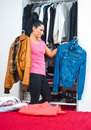 Woman in front of closet full of clothes Royalty Free Stock Photo
