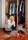 Woman in front of full closet Royalty Free Stock Photo