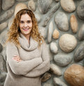 Woman in front of stone wall Royalty Free Stock Images