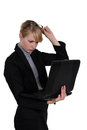 Woman frowning at her laptop Royalty Free Stock Photography