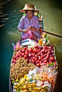 Woman in fruit boat in bangkok floating market Royalty Free Stock Image