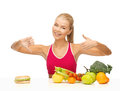 Woman with fruits and hamburger comparing food showing good bad signs Royalty Free Stock Photo