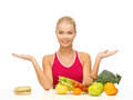Woman with fruits and hamburger picture of versus Royalty Free Stock Photos