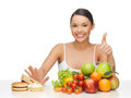 Woman with fruits showing thumbs up picture of Royalty Free Stock Photos