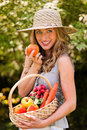 Woman with fruits and vegetables from the garden Royalty Free Stock Photography