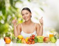 Woman with fruits and vegetables healthy food concept fresh showing thumbs up Royalty Free Stock Images