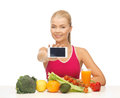 Woman with fruits vegetables and smartphone counting calories on Stock Image