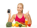 Woman with fruits vegetables and smartphone sporty showing Royalty Free Stock Photos