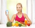 Woman with fruits, vegetables and tablet pc Royalty Free Stock Photos