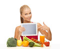 Woman with fruits vegetables and tablet pc sporty pointing at Royalty Free Stock Photography