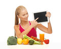 Woman with fruits vegetables and tablet pc sporty pointing at Stock Photos