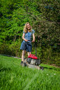 Woman and fuel grass cutting machine garden Royalty Free Stock Photo